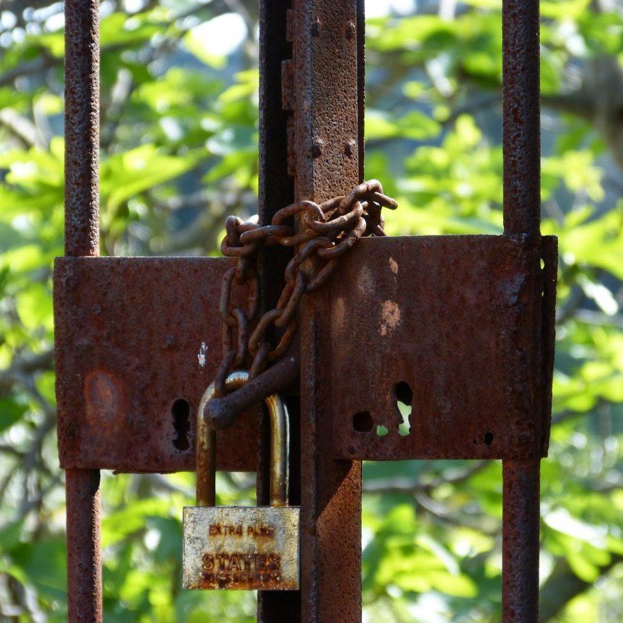 closed_symbol_padlock_abandoned_bars_rusty-1042327